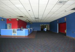 The lobby of the City Square 4 Theater.  The concession stand is on the left.  In the center at the far end is the hall to the theaters.  On the right are rest rooms.