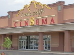 Above the entrance of the theater is the Coral Cliffs Cinema 8 logo, which has mountains in the background and the number 8 in the middle of the word Cinema. - , Utah