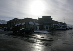 The retail space of the Country Club Marketplace.  The back of the office building is visible on the left. - , Utah