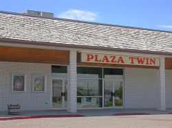 The front of the Plaza Twin.  The theater is listed in the phone book as the T & T Twin Theatres at the Plaza.  The 'T & T' stand for Tolbert Enterprises. - , Utah