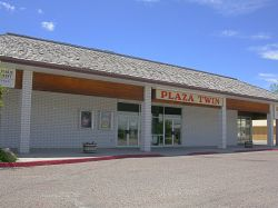 Front of the T & T Twin Theatres at the Plaza.  Out of the photo on the left is a bowling alley. - , Utah