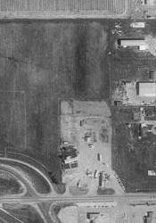 An aerial photo of the Moonlite Drive-In site in 1993.  The theater was located next to the northbound onramp for I-15. - , Utah