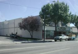 Trees obscure the front of the Murray Theatre in 2001. - , Utah