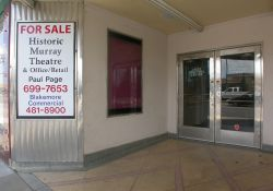 The left side of the Murray Theatre entrance has two poster cases and a set of double doors. - , Utah
