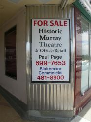 A 'for sale' poster on one of the diagonal walls in the Murray Theatre entrance. - , Utah