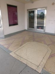 The outline of the ticket booth is still visible in the colored pattern on the entry floor.  The ticket booth was probably removed in the early 1960s as part of a trend of moving ticket sales to a counter inside the lobby. - , Utah