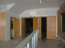 The right side of the lobby.  A divider separates the entrance doors on the right from the exit doors on the left.  Inside the auditorium, on the left, is a stairway to the balcony or projection booth.