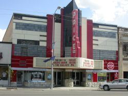 The front of the Price Theater.  There are shops on either side of the theater entrance. - , Utah