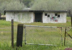Graffiti covers the front of the Ranch Drive-In's projection building.  On the right side of the building's doorway are two sets of projection windows. - , Utah