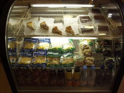 A refridgerated display case with pies and other desert items. - , Utah