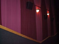 The walls of the auditoriums at the Redstone 8 Cinemas are covered with draperies in alternating shades of red. - , Utah