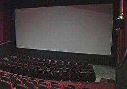 One of the larger theaters at the Redstone 8 Cinemas, from the back looking down at the 40-foot wide movie screen.  The four larger auditoriums have 175 to 193 seats each and feature stadium seating and Dolby Digital sound systems.