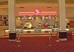 The lobby of the Redstone 8 Cinemas has the snack bar in the center, with seating on the left and ticket counter and theater entrances on the right.  The main entrance is behind the camera. - , Utah