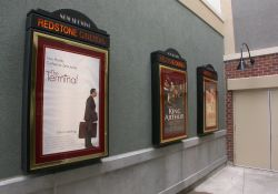On the left are three poster cases and on the right is an exit from the Redstone Cinemas. - , Utah