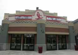 The Redstone Cinemas are located near ski slopes at Park City, Utah.  Above the theater entrance is image of a skier, with attraction boards on either side. - , Utah
