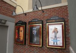 Three poster cases on a red brick wall outside the Redstone 8 Cinemas. - , Utah