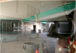 A view of the former lobby with a reflection of the parking lot on the window. - , Utah
