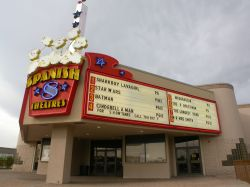 The theater has a triangular marquee with the name of the theater on the front and an attraction board on each side.  Underneath are two ticket booths with two ticket windows each. - , Utah