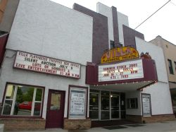 The theater has a triangular marquee over the entrance and a separate attraction board over the shop on the left side. - , Utah