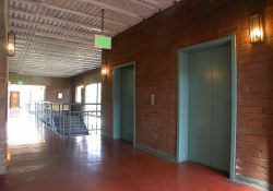 Two elevators provide access to offices on the fourth level of the Trolley Corners complex.