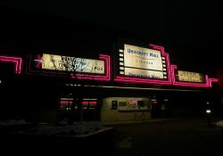 Neon around the sign and attraction board of the Festival Cinemas at University Mall at night. - , Utah