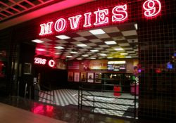 Above the entrance is the name of the theater, 'Movies 9', written in neon. - , Utah