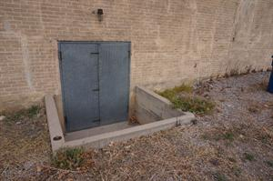 To the right of the exit is a bricked up window or coal chute. - , Utah