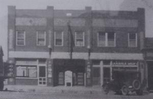 An undated photo of the Avalon, posted above the thermometer on the right side of the entrance.  Note the blade sign, lack of triangular marquee, and the original entrance doors. - , Utah