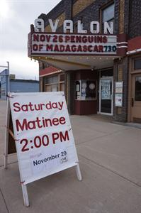 A sign on the sidewalk alerts passersby about a 2 PM Saturday matinee on Thanksgiving weekend. - , Utah