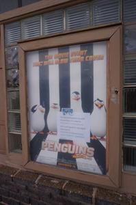 A poster case in the left storefront. - , Utah
