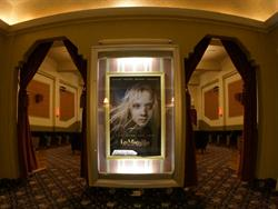 A large poster case, between archways into the auditorium. - , Utah