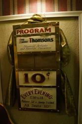 """A restored attraction board advertises the Three Thompsons, """"Musical Artists and Novelty Dancers."""" - , Utah"""