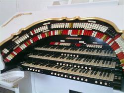 The organ console has two circular rows of stops and three keyboards. - , Utah