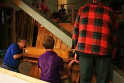 Workers install a section of the pipe organ. - , Utah