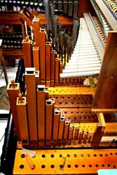 Square wooden pipes rise from a wind chest. - , Utah