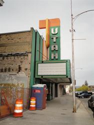Orange cones and temporary fencing mark the construction site on the left side of the Utah Theatre. - , Utah