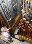 Michael Ballam stands among the pipes of the theater's organ. - , Utah
