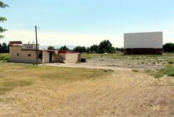 Weeds encroach on the Sunset as the drive-in sits idle following a fire. - , Utah