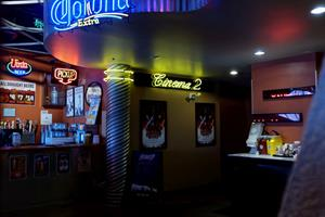 At the end of the hall is a concessions counter and neon lettering identifying each auditorium. The entrance to Cinema 2 includes a door to the projection room. The entrance to Cinema 1 is just out of the photo on the right. - , Utah