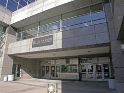 The entrance of the theater is recessed in the lower level of the two-story building. - , Utah