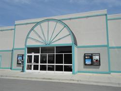 The entrance of the theater has two poster cases on either side and a half-circle neon pattern above. - , Utah