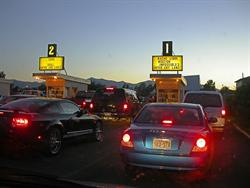 Cars approach the first two ticket booths at the Redwood Drive-in. - , Utah
