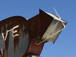 A section of neon clings to the arrow on the west end of the sign. - , Utah