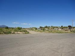 200 North, with the sign for the Kigalia Drive In on the right. The entrance to the drive-in was most likely the less-used dirt road on the left. - , Utah