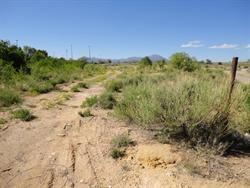 A rusted post stands on the right side of a dirt road leading back to the former site of the Kigalia Drive In. - , Utah