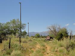 Tall lamp posts mark the edge of a baseball park that now stands on the site of the Kigalia Drive In. - , Utah