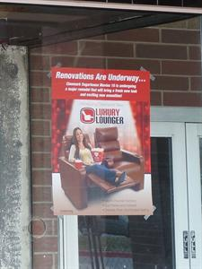 A flyer for Luxury Loungers taped to the box office window. - , Utah