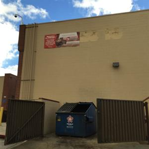 "The old ""Movies 10"" sign on the back side of the building is replaced by a Luxury Lounger banner. - , Utah"