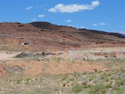 Asphalt is gathered in a pile on the left, possibly in preparation for gravel mining. - , Utah