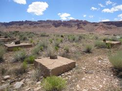 Looking southwest across two rows of concrete foundations for the screen tower. - , Utah